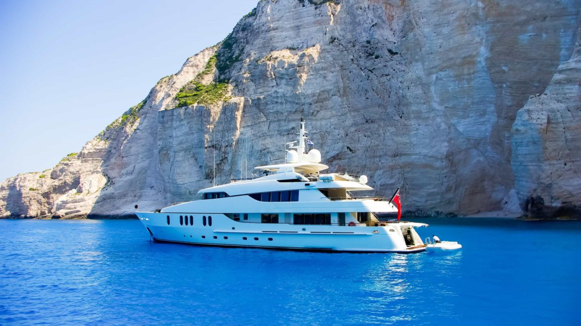 View from the top of a large white yacht at Navagio Beach.