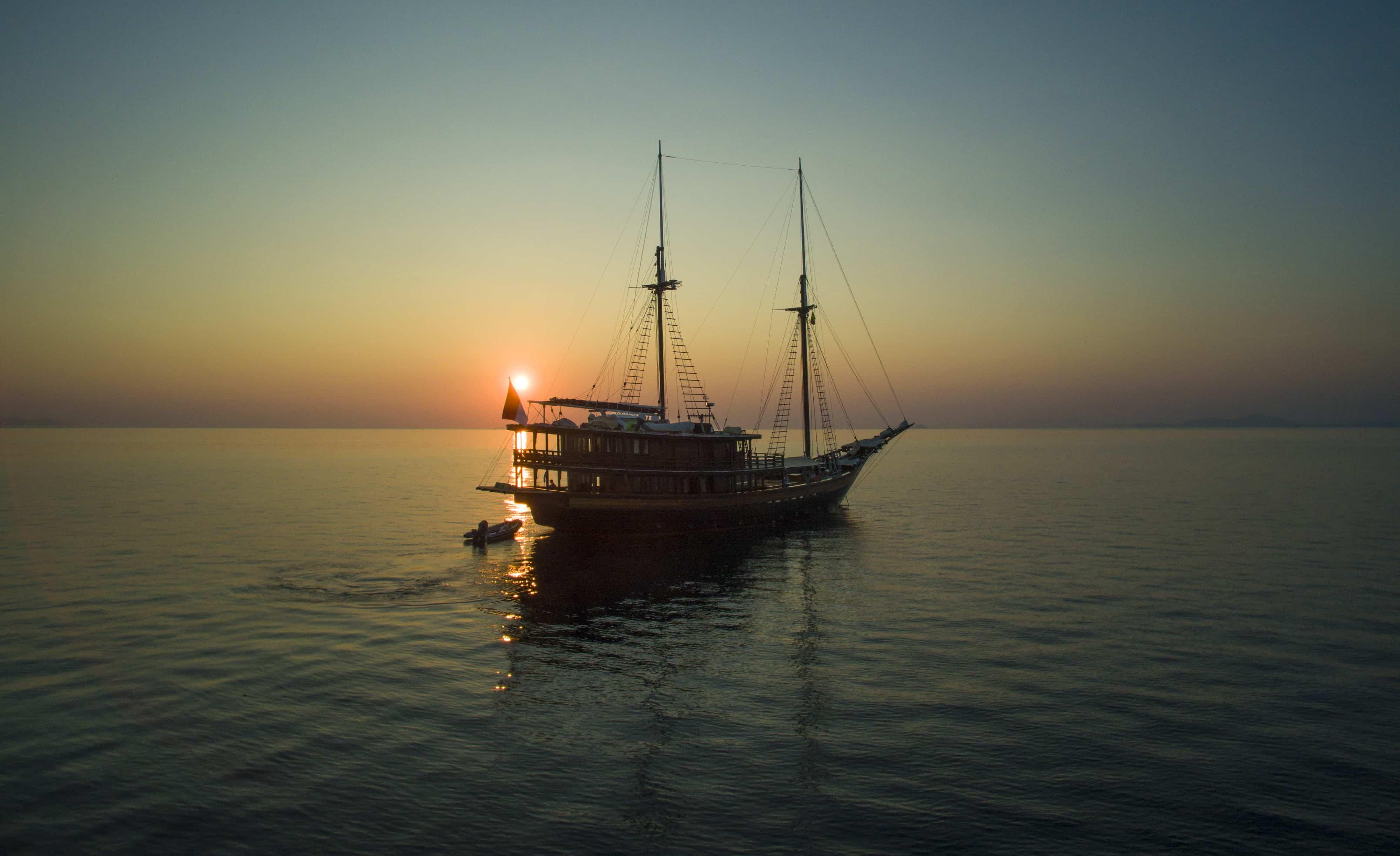 Sailing yacht Dunia Baru at sunset.