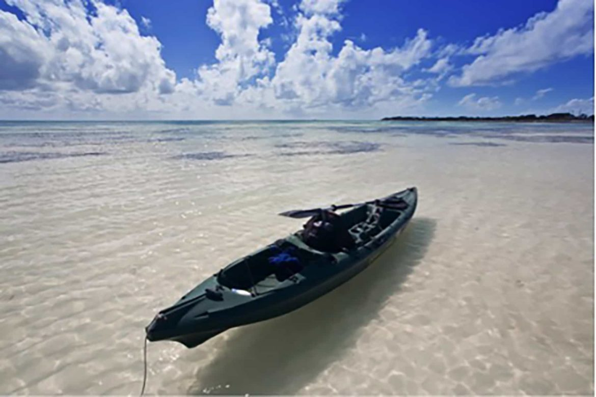 A canoe in the shallow coastal waters of Florida