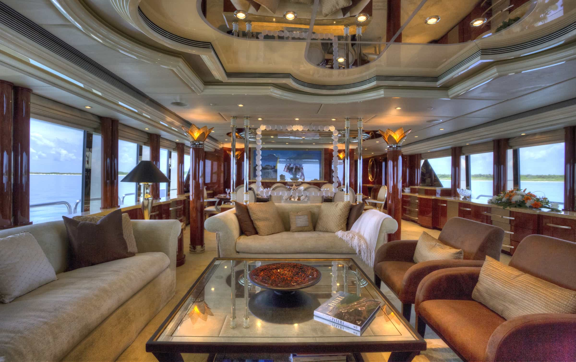 salon onboard I Love This Boat finished in creams and dark browns