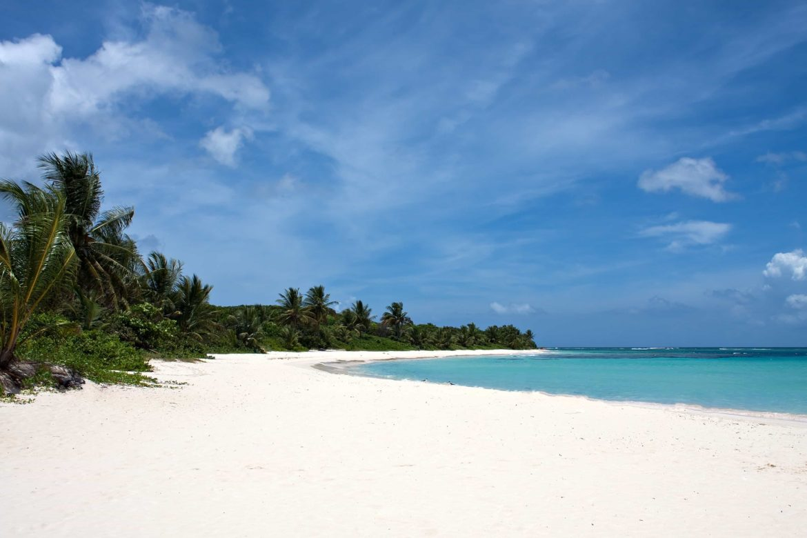 Tropical white sand beach for you to enjoy on your Spanish Virgin Island yacht charter
