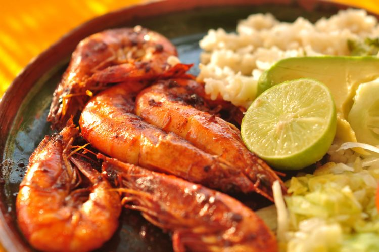 close up of grilled shrimp and rice