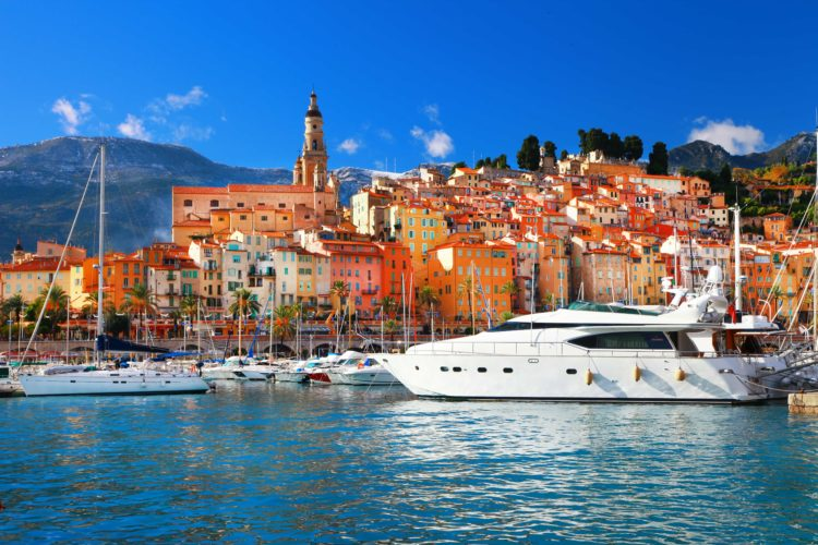 Yacht docked in the colorful port of Menton in the south of France