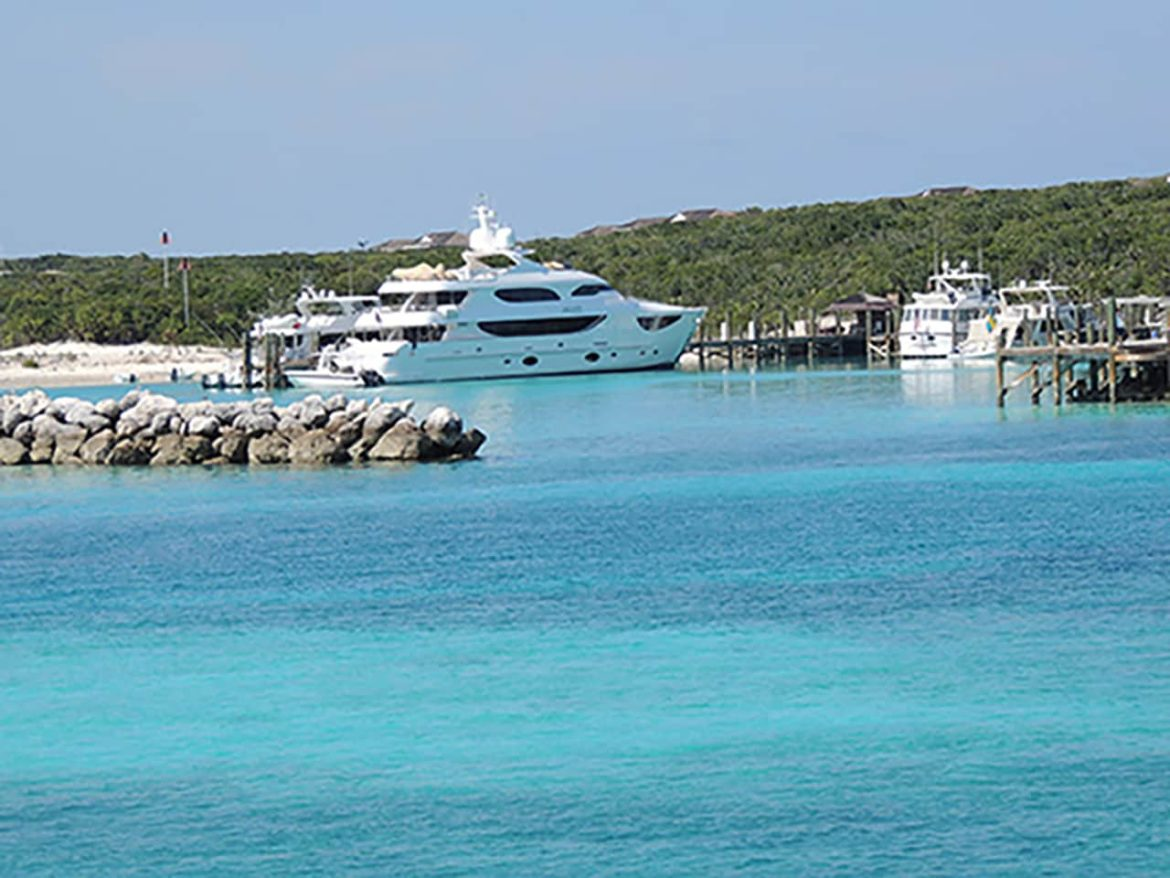 Yacht docked in a harbor in the Bahamas