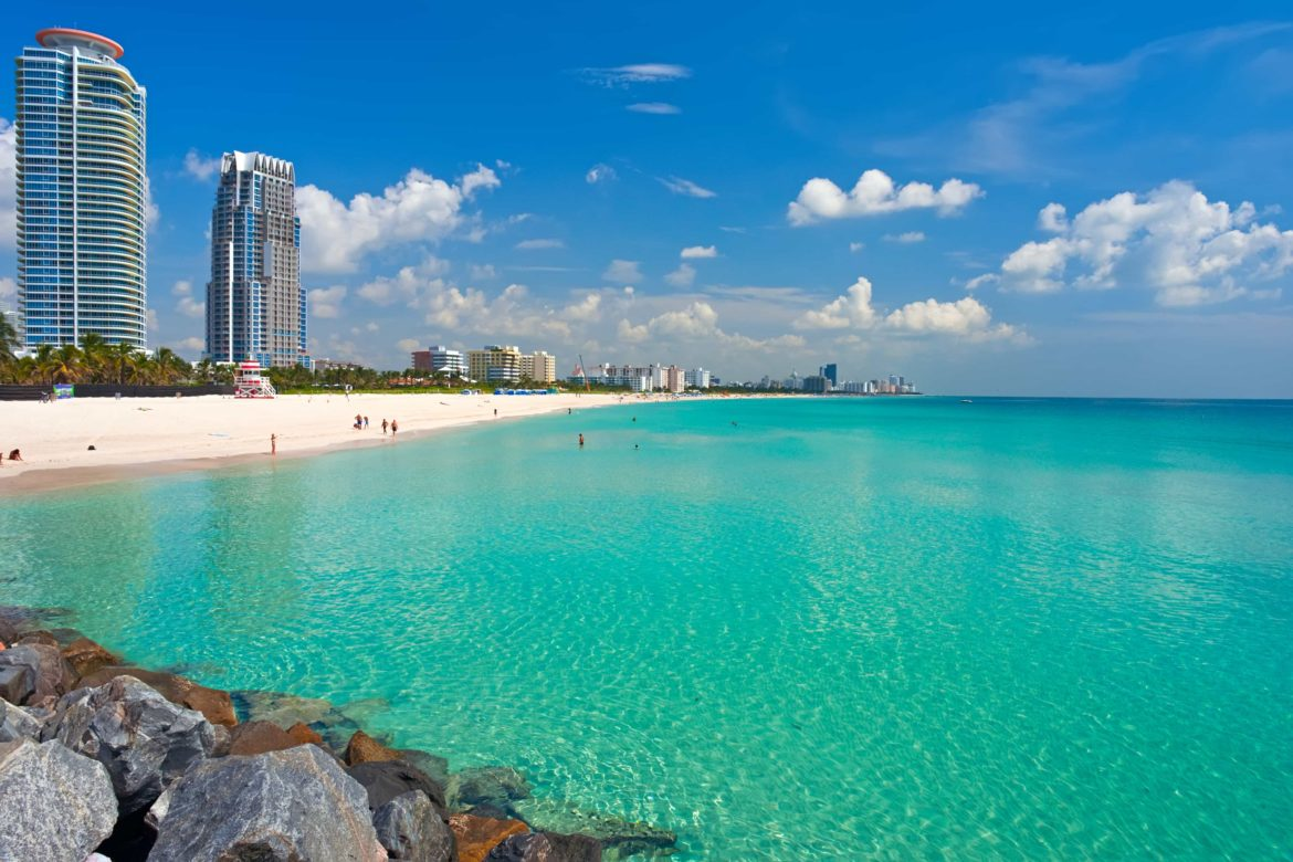 White sand beachs, aquamarine water, and skyscrapers of Miami