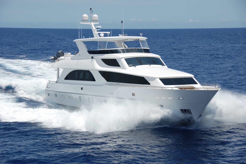 Motor yacht cruising and leaving a wake behind
