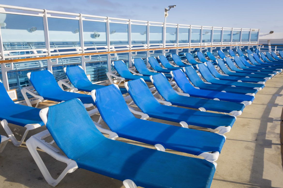 dozens of deck chairs on a cruise ship