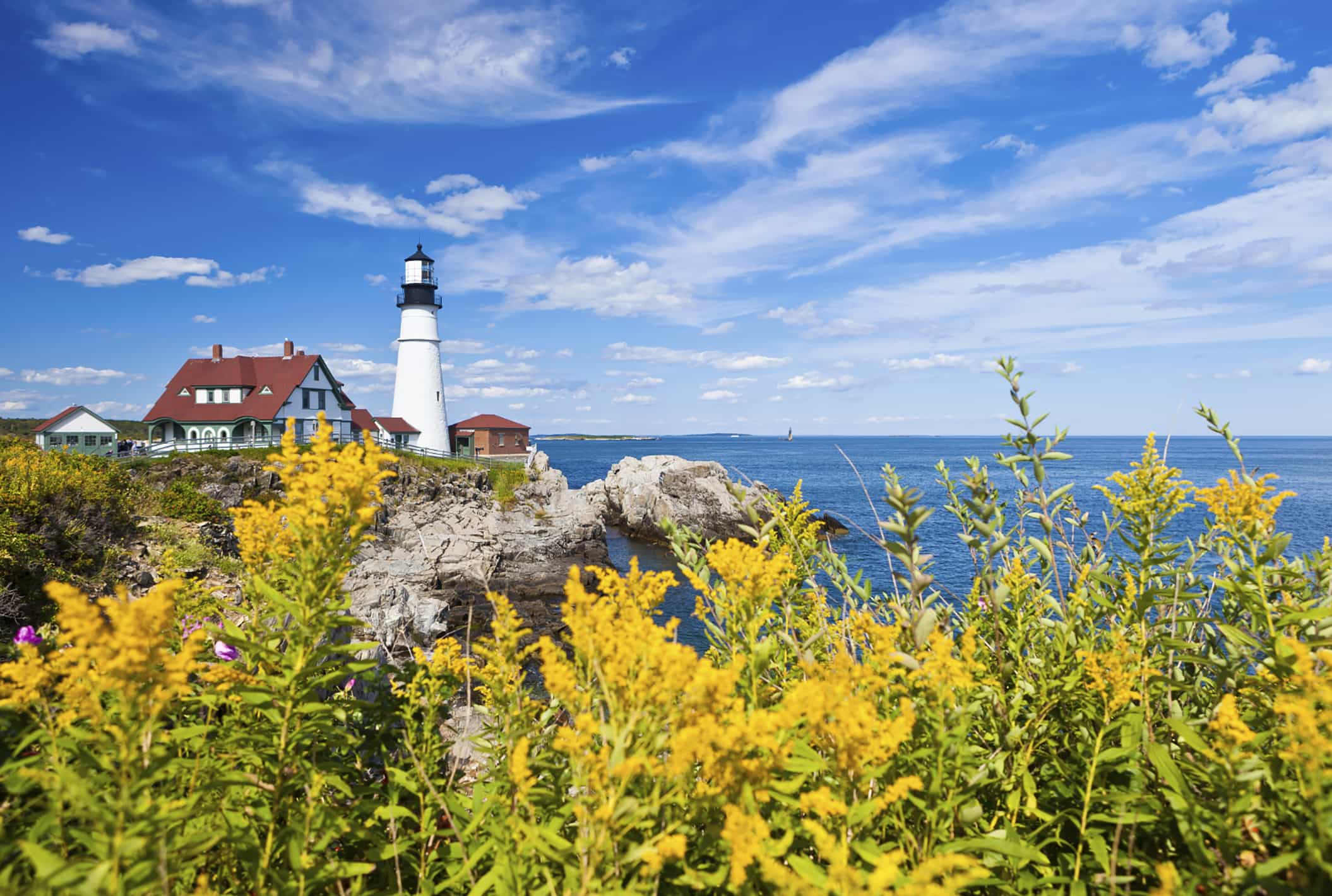 lighthouse and cottage on New England coast