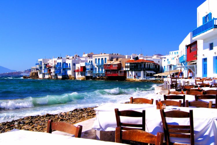 table and chairs on beach in Greece