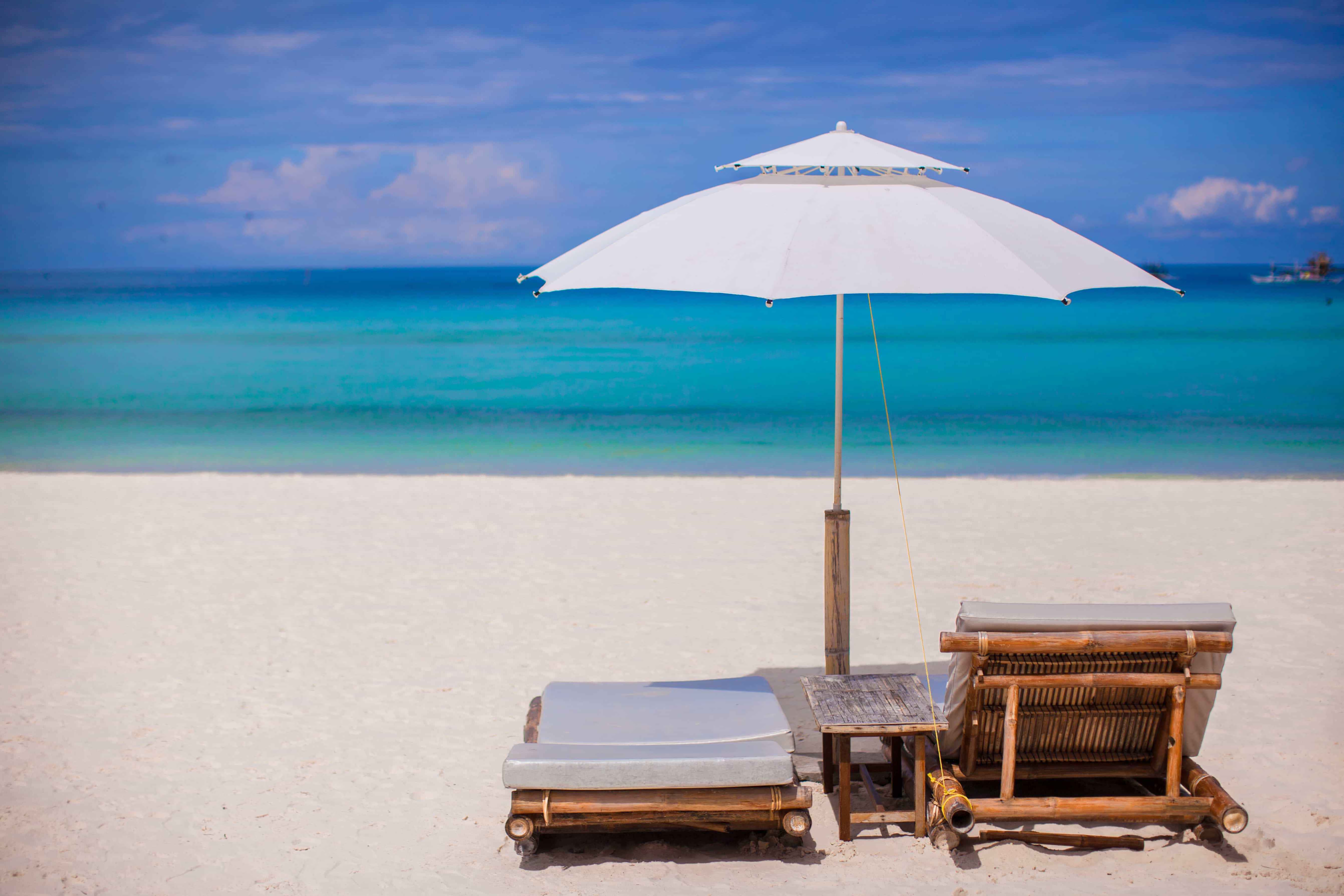 Wooden chairs on tropical beach vacation