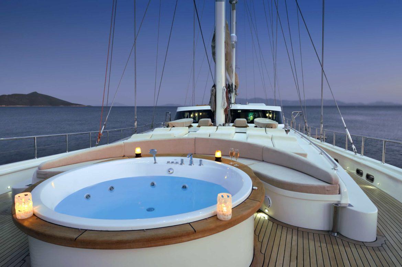 candlelit jacuzzi on bow of large catamaran at dusk