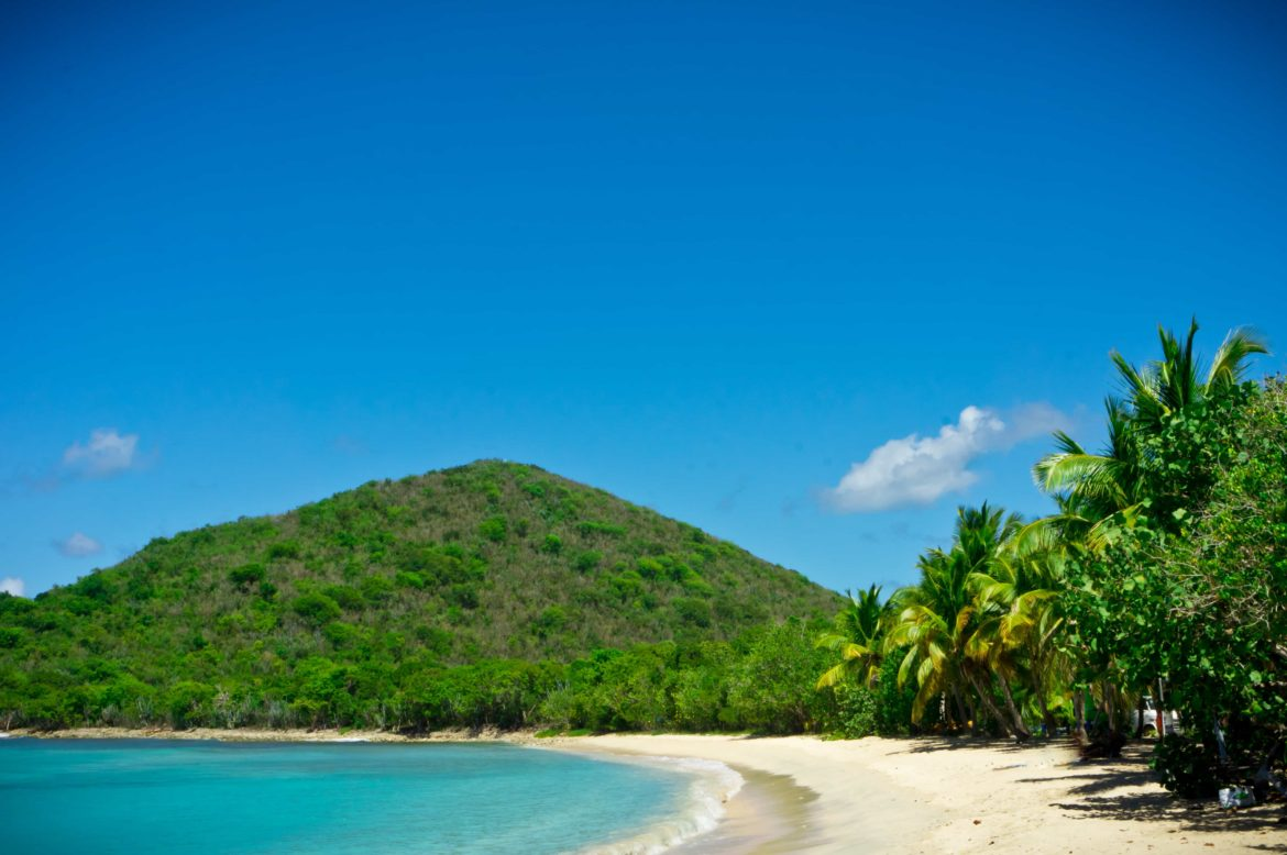 Deserted tropical beach you can explore on your BVI yacht charter