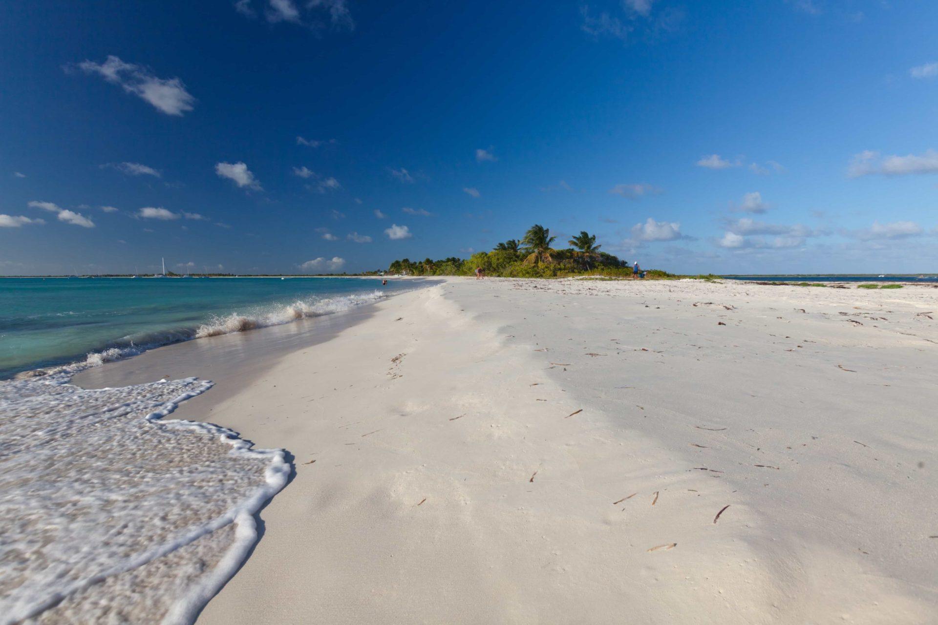 deserted white sand beach in Caribbean