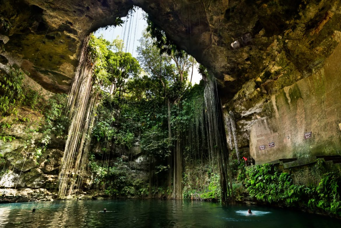 Ik Kill Cenote, a rainforest cave pool that drips with jungle vines.