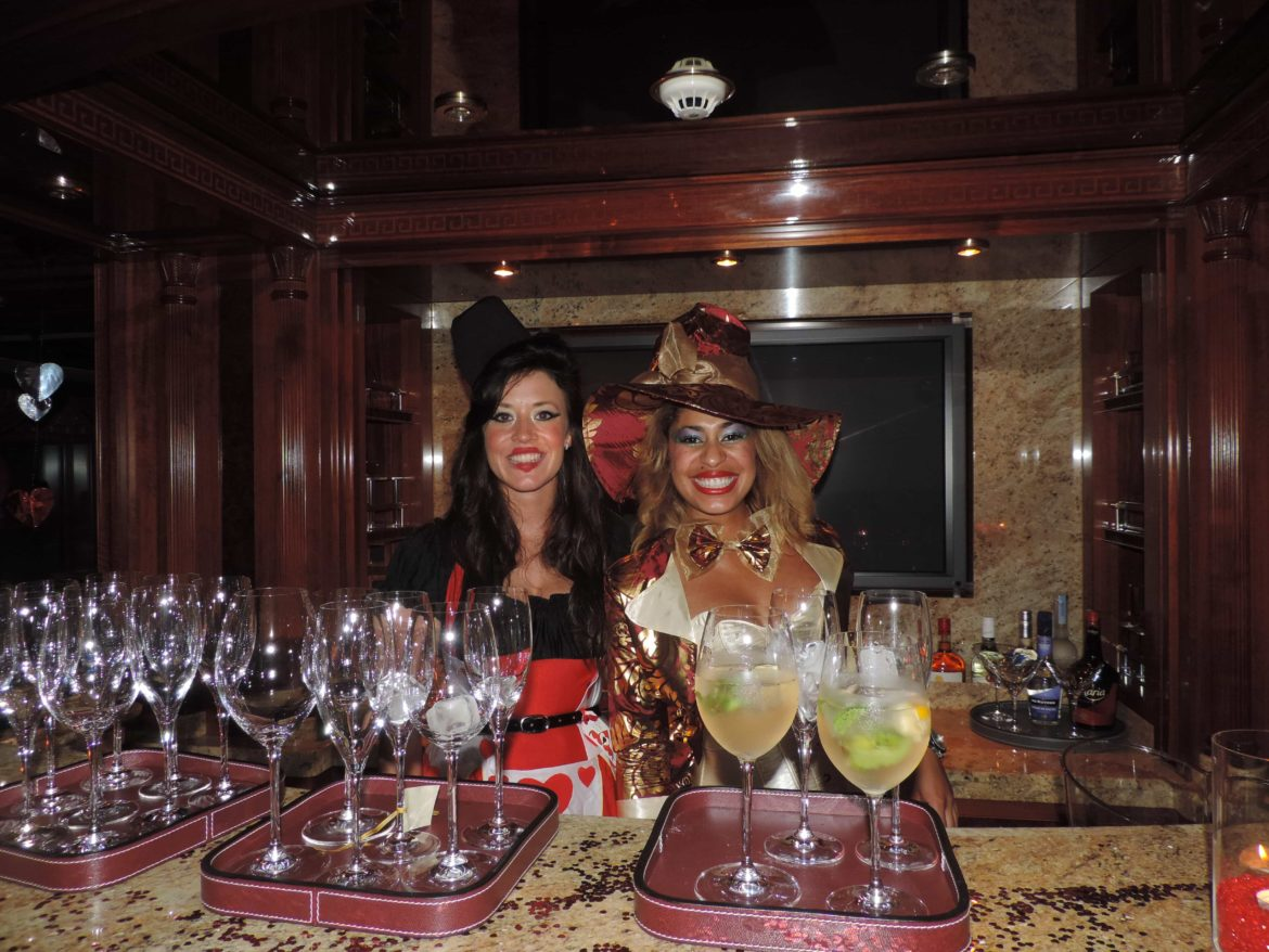 two yacht stews smiling in fancy dress for a themed cocktail night onboard
