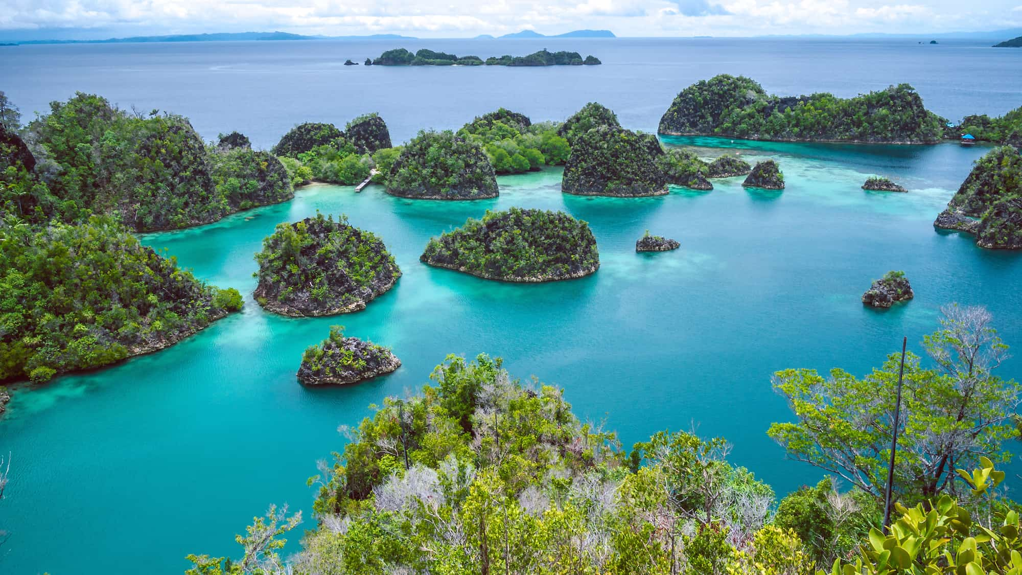 aerial shot of Raja Ampat islands for a winter escape