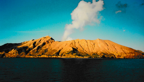 Smoke rising from a volcanic crater