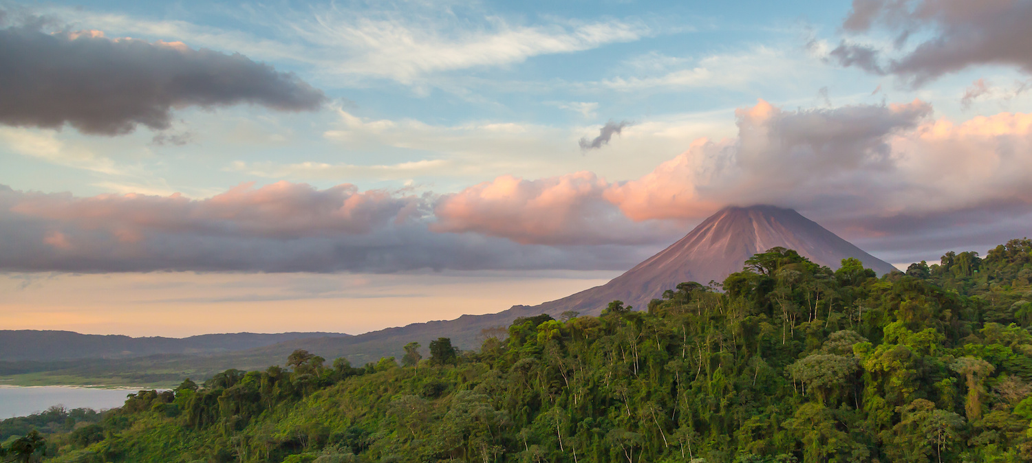 Lush forrest and a volcanic mountain, the views you'll see on your Costa Rica yacht charter are stunning.