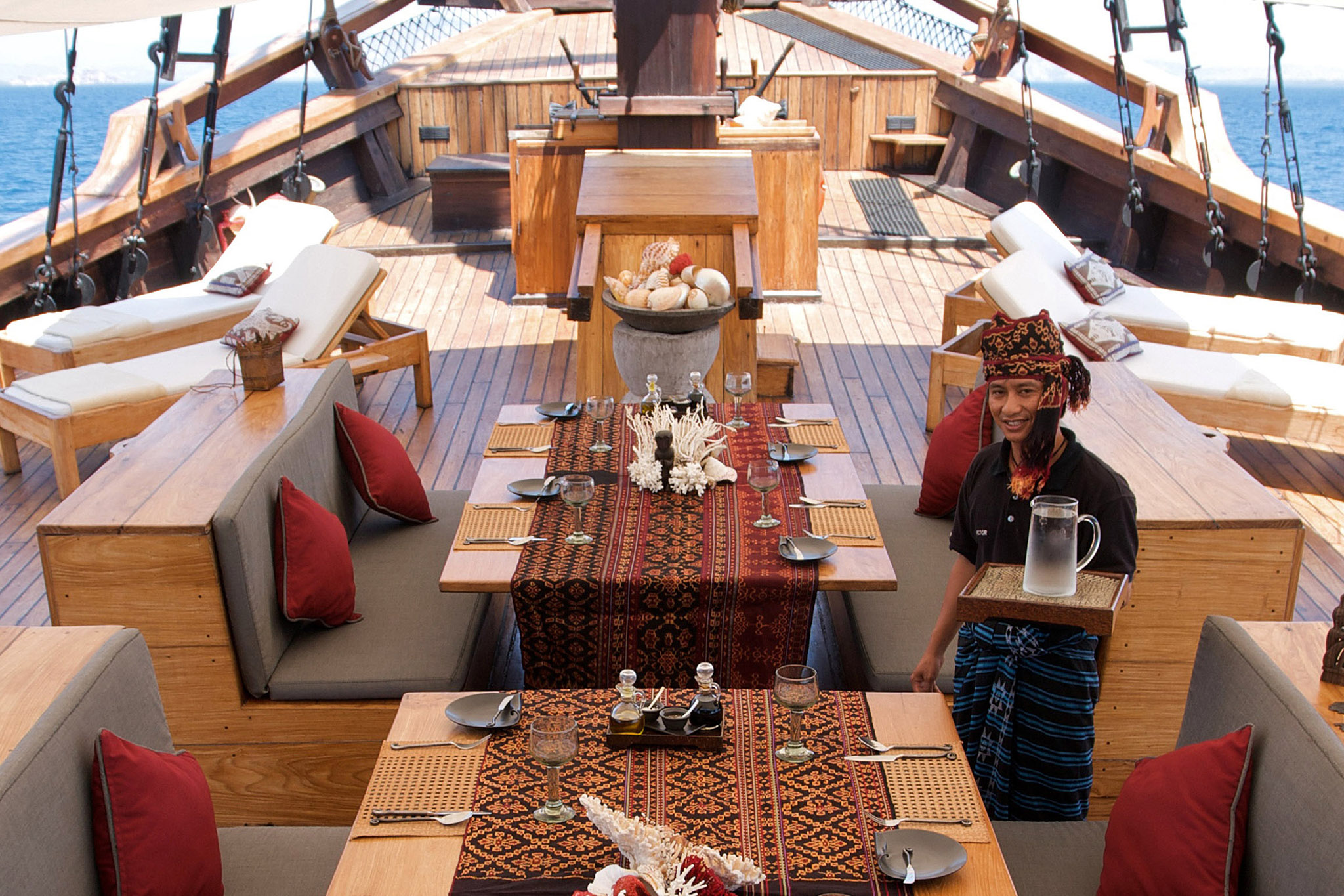 bow of luxury yacht Silolona with table set for lunch