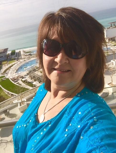 selfie of woman in front of resort