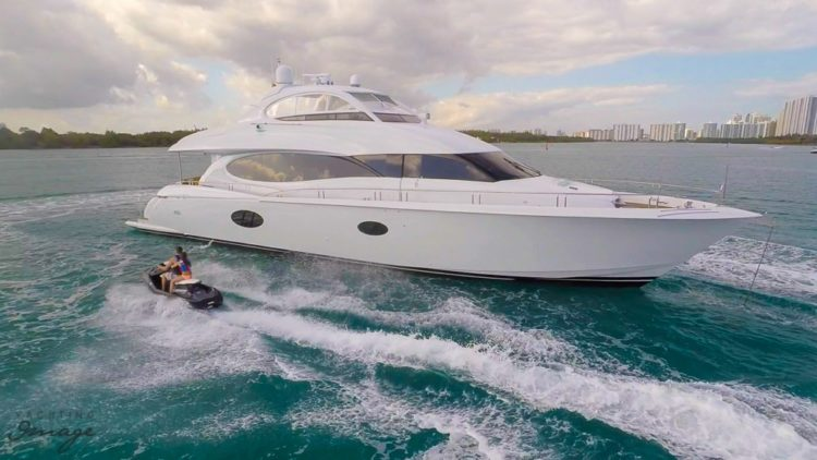 Yacht chip at sea with waverunner nearby