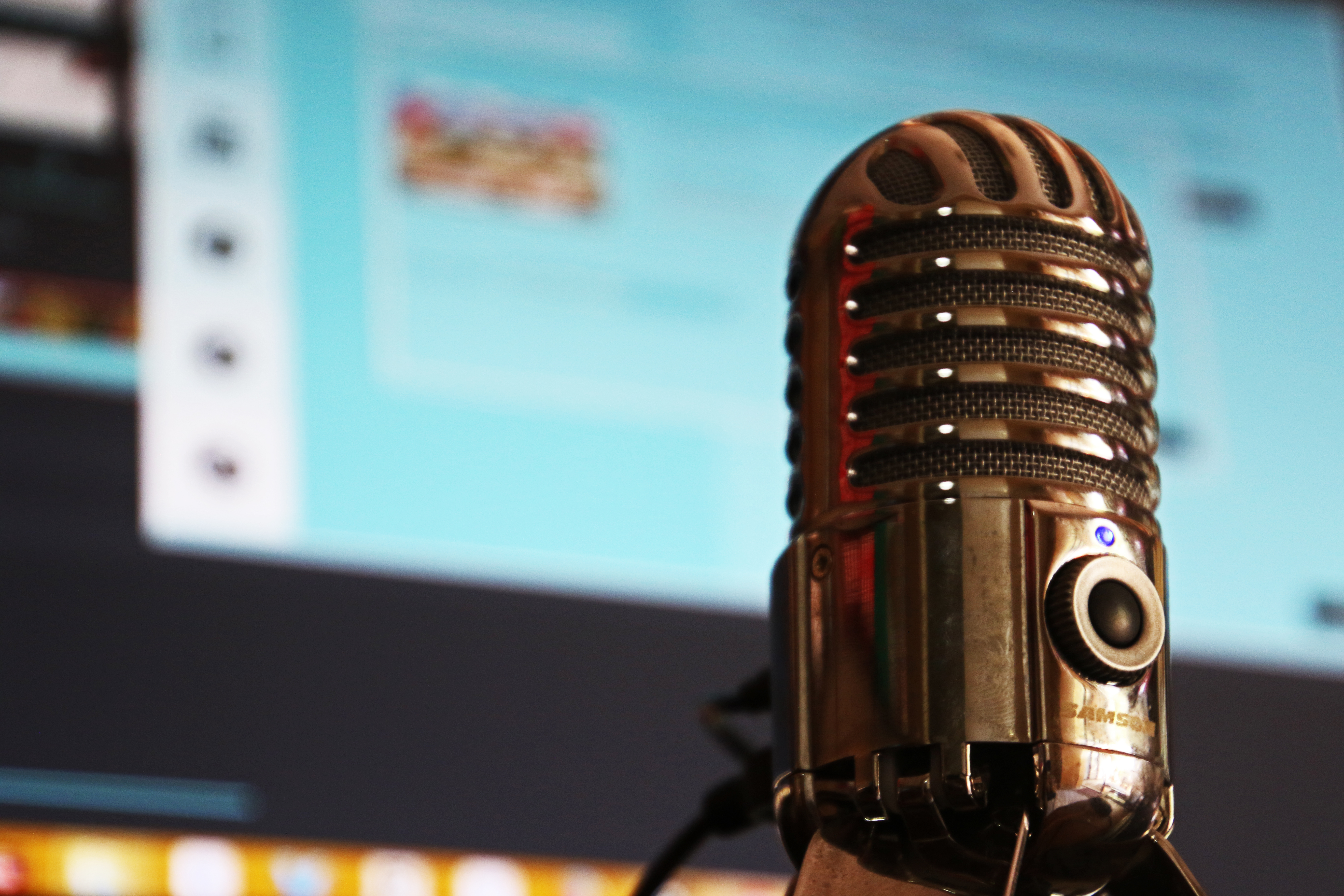 stock image of a microphone in front of a computer