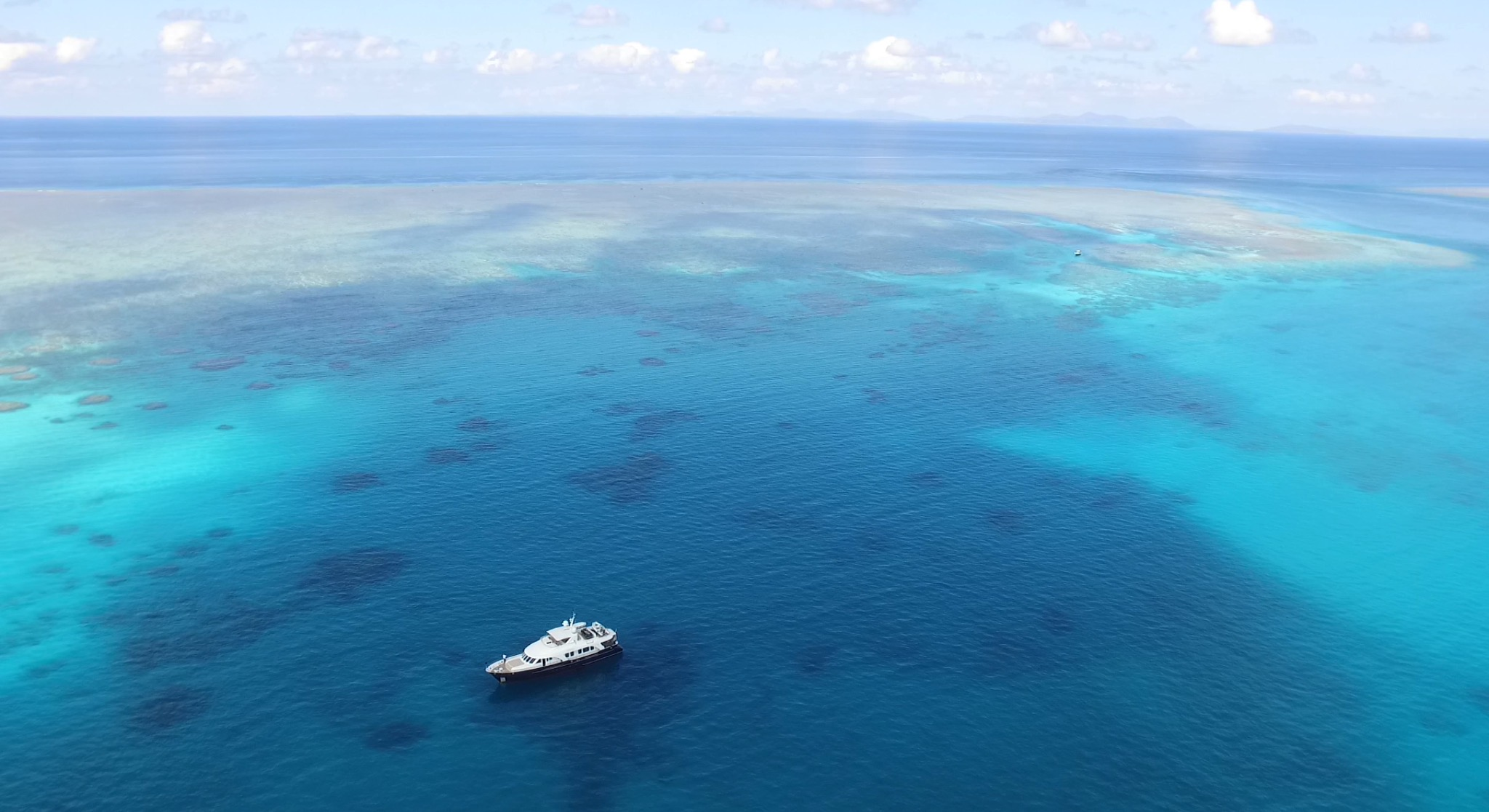 aerial of a yacht in the Great Barrier Reef