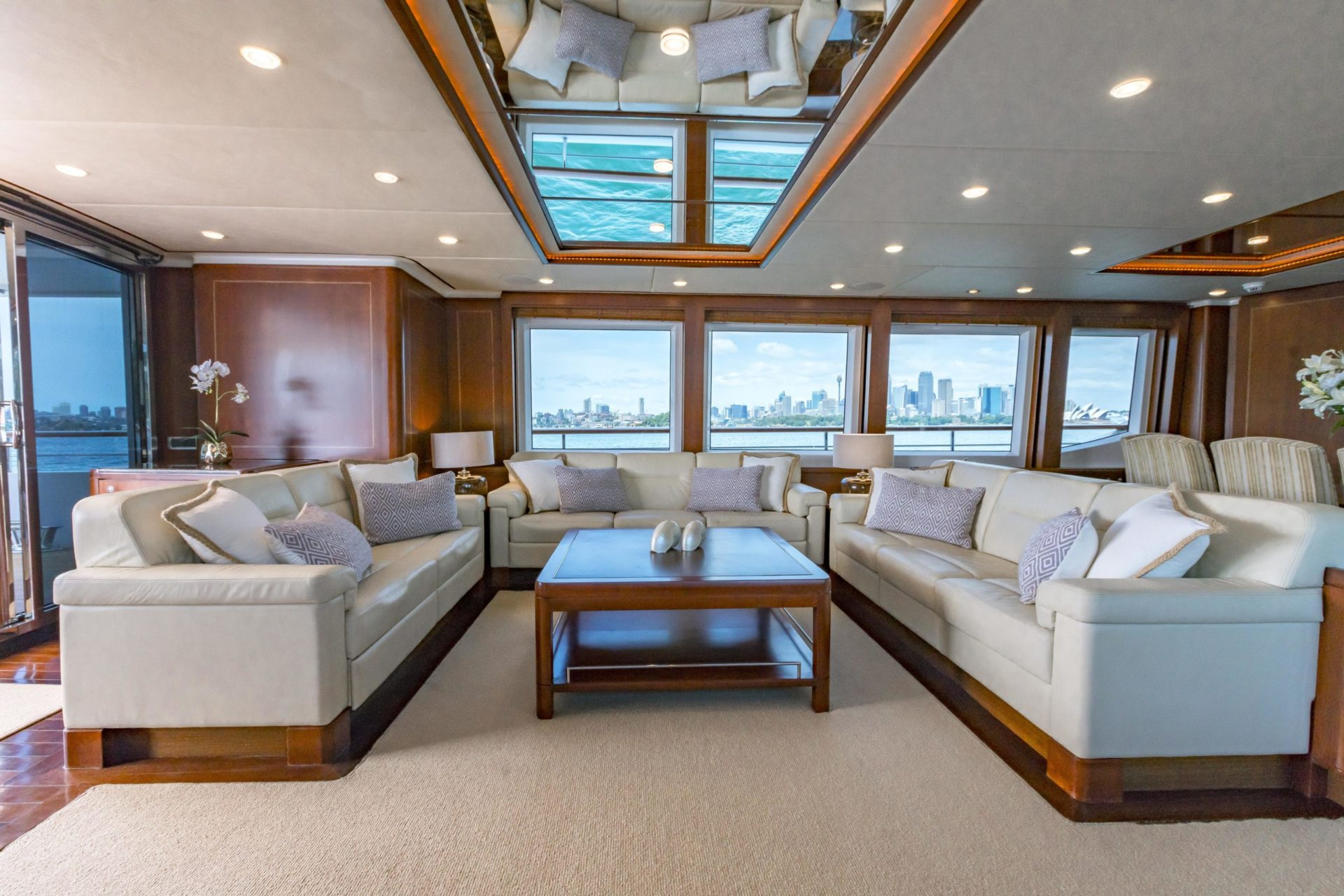 white sofas and large windows onboard Masteka 2 in the main salon