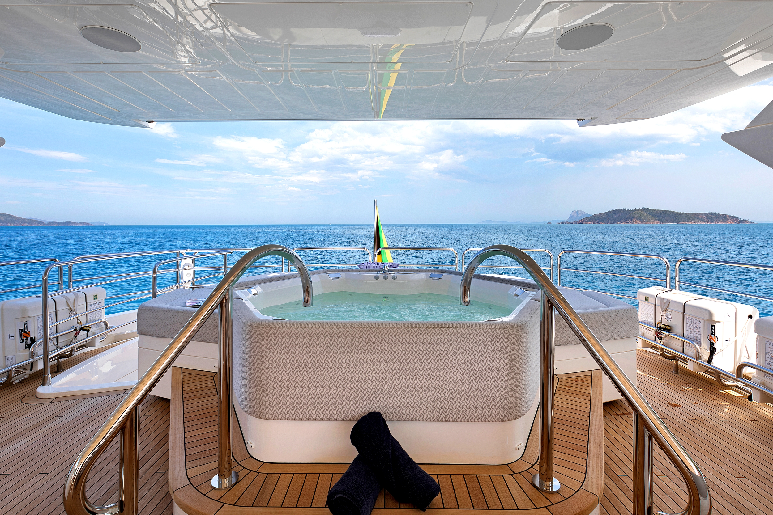 view of the jacuzzi onboard yacht Settlement with the ocean in the background