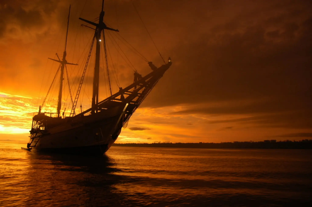 phinisi sailing yacht at sunset