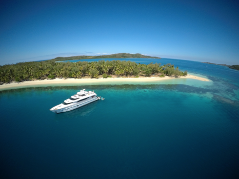 superyacht on secluded white sandy beach