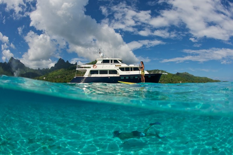 paddle boarding and snorkeling on a yacht charter