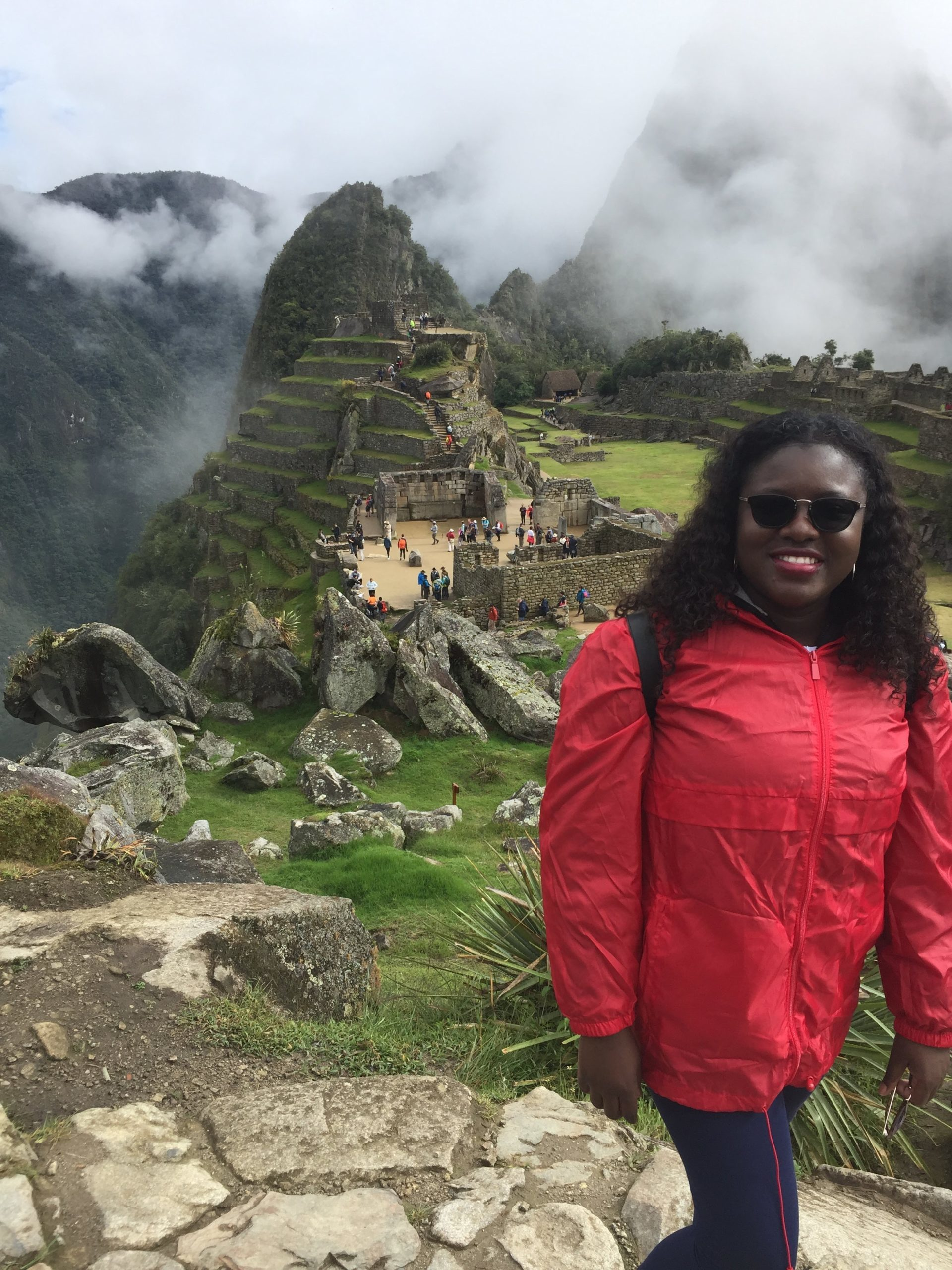 Black woman standing in front of Machu Picchu