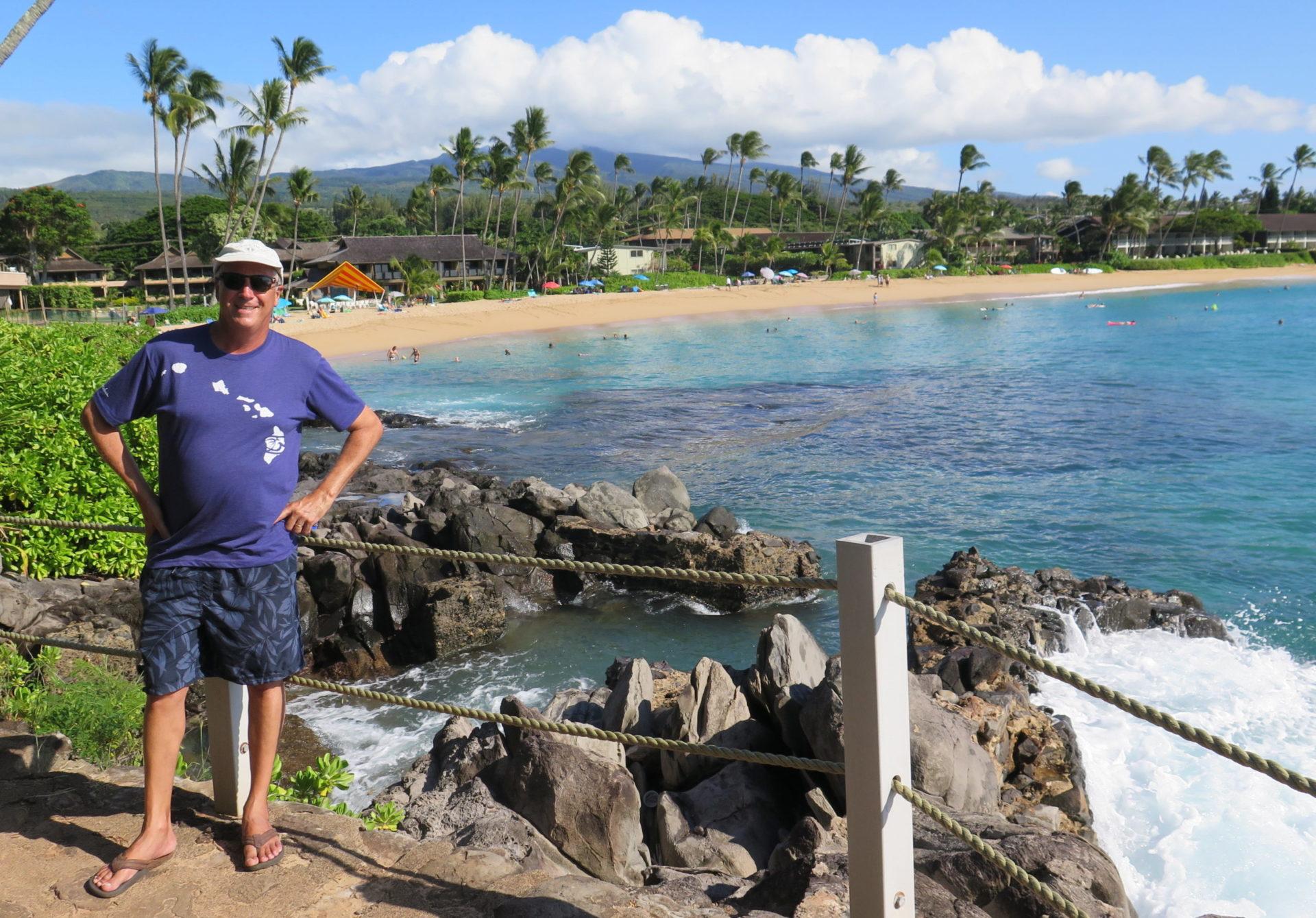 Jim Byers standing beside beach in Hawaii