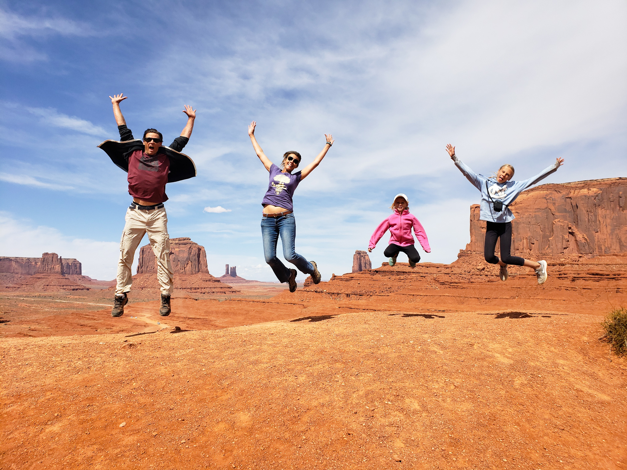 The family behind YTravel Blog jumping in the air in the desert