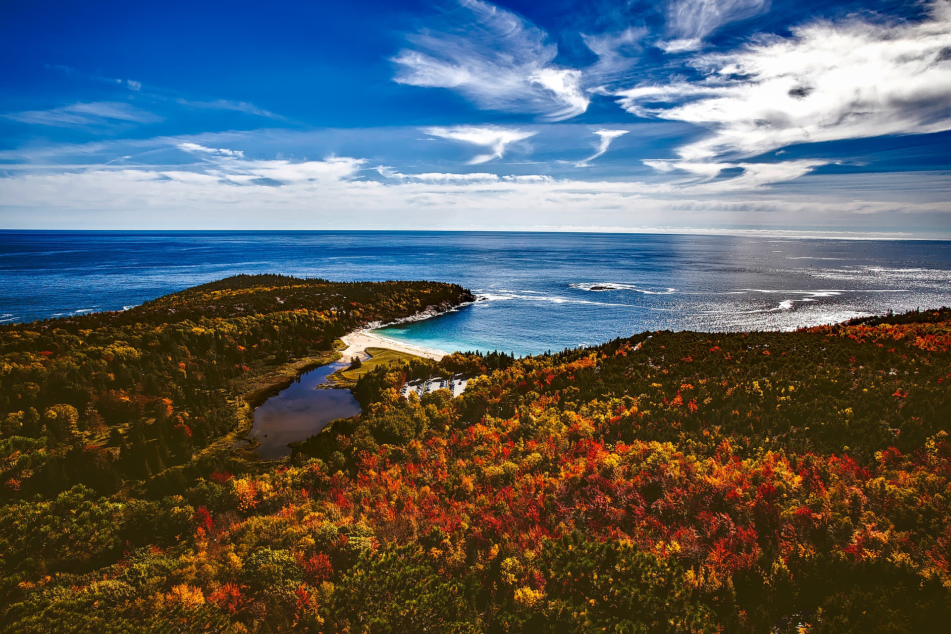 aerial shot of the coastline of Maine with coloured leaves in the fall