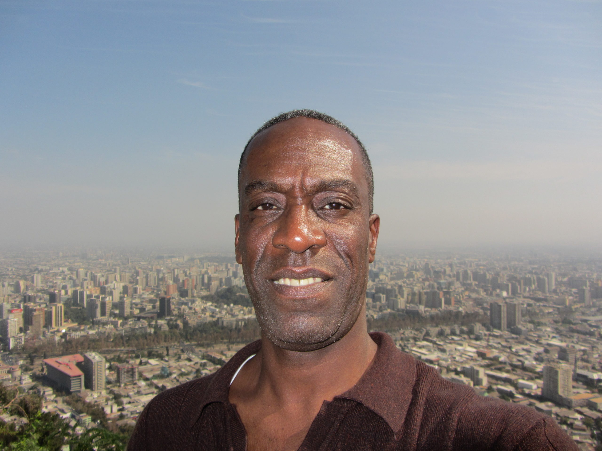 Travel journalist Brian Major takes a selfie with Santiago, Chile in the background