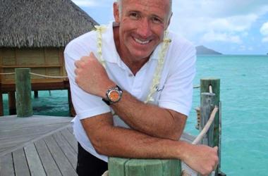 Tahiti travel expert Carl Henderson in front of over water bungalow in Tahiti