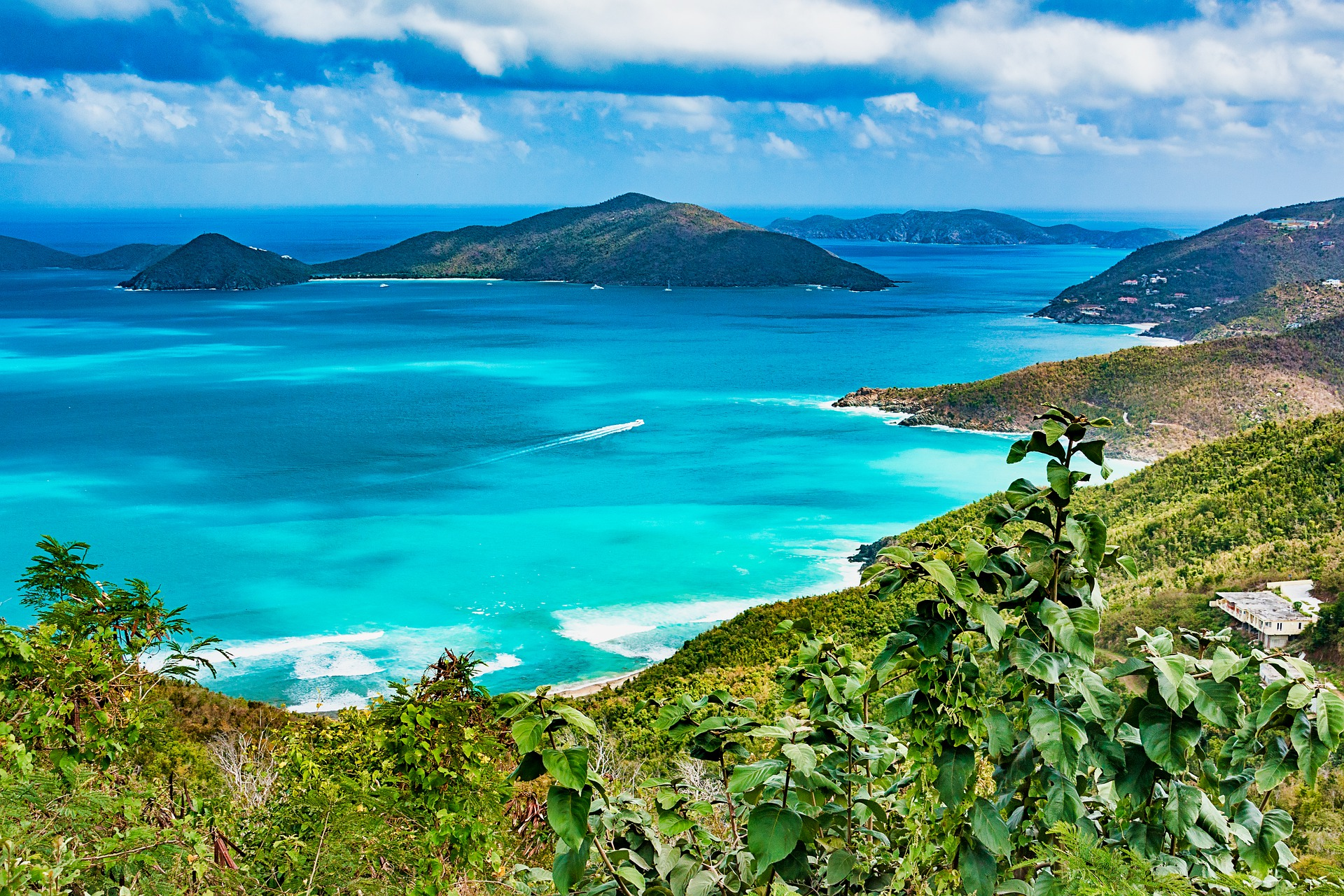 aerial photo of the British Virgin Islands with turquoise waters and mountains